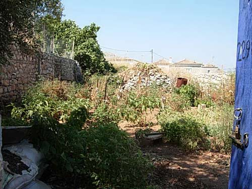 A good sized building plot in Kamini, with solid stone walls around and enough stone on the site to build a house.