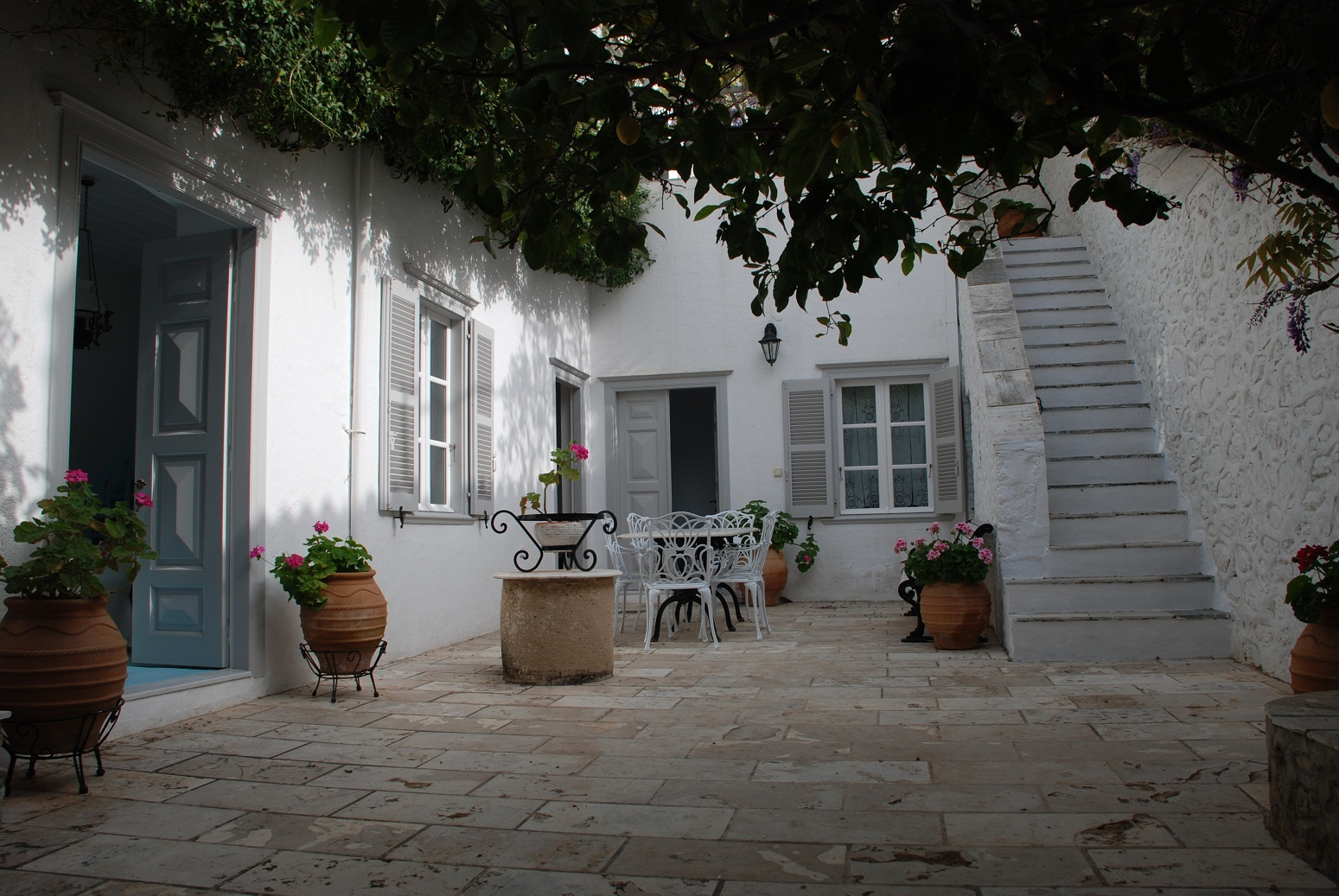 The Courtyard house is a newly-renovated 18th-century stone house in the heart of Hydra town.  Sleeps up to 10 people.