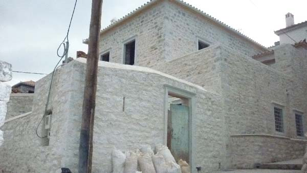 Brand new stone built house with exposed wooden ceilings.